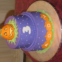 Jack-O-Lantern Birthday Cake   This is a Halloween themed birthday cake decorated with buttercream icing and marshmallow fondant