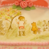 Pooh Bear Shower Cake Ten inch round strawberry cake with French vanilla b/c with fondant bow, rolled roses and painted plaque.First time trying painting. I'...
