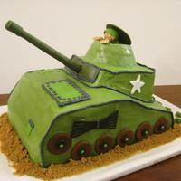 Zebedee's Tank Carved 9 x13 for my son's 11th birthday.Vanilla B/C with fondant accents.Barrel is a fondant wrapped dowel.