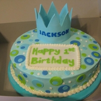 Jackson's 1St This is a 12 inch round icing in buttercream with fondant circles and plaque. Crown was made of gumpaste. The letters were Wilton stick one...