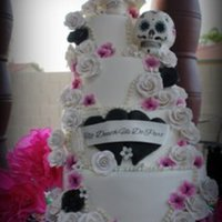 Wedding Cake Featuring Hand Sculpted Sugar Skulls And Sugar Flowers Wedding Cake Featuring Hand Sculpted Sugar Skulls and Sugar Flowers