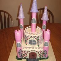 Castle Cake  For a little 6 year old b-day, princess theme. Bottom is 2 8in square, top is 2 6in round, buttercream icing with gumpaste/fondant and...