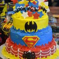 Super Hero Cake top yellow cake, middle white, bottom chocolate