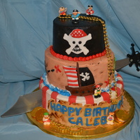 Pirate Cake This was for my sons 5th birthday party. Buttercream with fondant and royal icing accents and toy sword