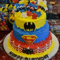 Super Hero Cake This was for my sons 4th Birthday. Top Yellow, Middle White, bottom chocolate. This was a combo of a few cakes I saw on here with a touch...
