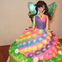 Fairy Cake Pina Colada cake with B/C frosting and fondant petals. Wings made from Jolly Ranchers.