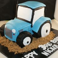 3D Tractor Everything is edible. Wheels are amde using rice treats. Alot of fun to make.