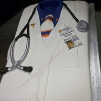 Doctor's Jacket   Sheet cake, with fondant Badge made from ediable image. This was for a grad from med school