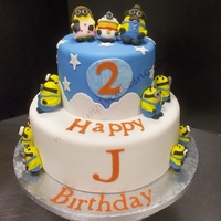 Despicable Me   Fondant covered, characters are made of fondant. Letters I did with cake cricut
