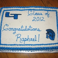 Raphael's Graduation Cake White cake, raspberry filling and BC icing. FBCT helmet and logo. Silver star glitter