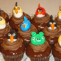 Angry Birds Chocolate Fudge Cupcakes chocolate fudge cupcakes dipped in chocolate ganache, topped with a swirl of chocolate fudge buttercream, and finished with the fondant...