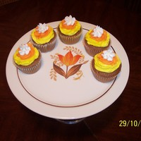 Candy Corn Cupcakes I saw Eva2's version of these, thought they were so cute and had to make them myself. Spice cake with Vanilla-Almond buttercream