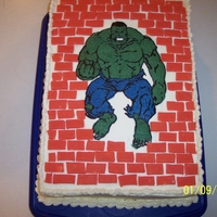 Incredible Hulk Hulk is a FBCT, bricks are gumpaste. Made for my grandson's 9th birthday. Half chocolate, half funfetti cake iced with Almond-Vanilla...