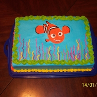 Nemo Dark chocolate cake iced with Vanilla-Almond buttercream, Nemo is a FBCT. Cake for my 2 year old Granddaughter's birthday.