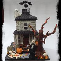 "Halloween Haunted House This creation was made for a Halloween party. It is based on a cake by ""Tickle Your Fancy Cakes"". The House is cake covered in..."