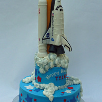 3,...2,..1,.. Ignition, ... We Are Go For Space Shuttle Birthday Cake! Space Shuttle cake. Packed RKT rockets, fuel tank, and space shuttle covered in MMF details. Each shuttle component was hand sculpted after...