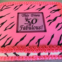 50Th Diva Birthday Customer wanted the Zebra stripes...but without fondant. So, I printed them on to icing sheets and painstakingly cut them out.