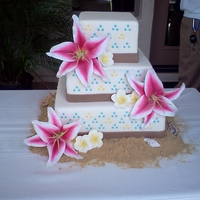 Tropical Themed Wedding My bride saw a photo ( http://cakecentral.com/gallery/1661379/wedding ) and asked me to create something similar using lilies and gumpaste...