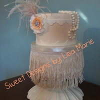 The Roaring 20's The color didn't photograph well. The background was an antique white with white trim and an off white to peach flower. It was for a...