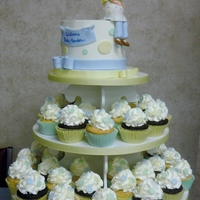 Landon's Baby Shower  Cupcake tower for a baby shower with a fondant pregnant women topper. I know people make these toppers all the time but, I think mine are...