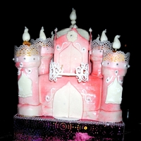 Princess Castle Bottom layer is vanilla with strawberry filling. Top layer is chocolate cake with vanilla filling. Towers are ice cream cone brownies,...