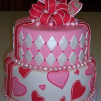 Valentine Sweet Sixteen Two Tiered cake covered in fondant. All decorations are fondant with buttercream and pearl dust accents.
