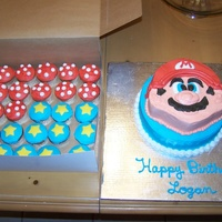 Super Mario Cake With Stars And Mushroom Cupcakes This cake was for a little boy's birthday. It is all buttercream, except for the stars on the cupcakes. Those are fondant.