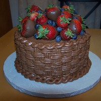 Chocolate Basketweave With Chocolate Covered Strawberries This is a chocolate butter cream basketweave with chocolate covered strawberries on top. I added some blueberries to give it a little more...