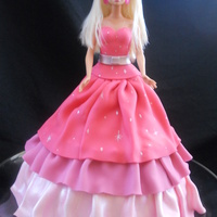 Allie This was for a five year olds birthday. She LOVES Barbie. Chocolate cake covered in fondant ruffles.