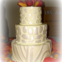 Lillian This was for a wedding that took place at the local zoo. All butter cream with fondant accents covered in super pearl.