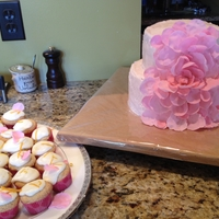 Pink Flower Petals Petals made with fondant. Chocolate cake & butter cream. cupcakes are screwdriver w/orange zest