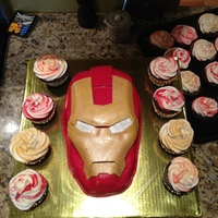 Iron Man Cake For Colin's 4Th Birthday Iron man cake with cupcakes- cake is white with buttercream and fondant . chocolate cupcakes