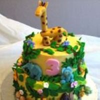 "Jungle Cake Done for a little girl who loves animals especially "" Giraffe"" All buttercream with fondant accents."