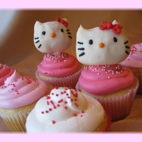 "Hello Kitty Cupcakes Heads made using same method as ""cake pops"". Royal icing bows."