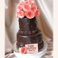 Chocolate And Pink Roses Covered in poured chocolate ganache. Fresh pink roses. Pink chocolate plaque.