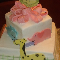 This Was Done In Buttercream With Fondant Animals And Ribbon The Cake Matched The Invitation Other Animals Such As A Lion Was On The Other... This was done in buttercream with fondant animals and ribbon. The cake matched the invitation. Other animals such as a lion was on the...
