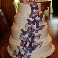 Purple Butterflies This is a buttercream cake with edible butterflies that were purchased at Etsy.