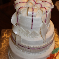 Buttercream Cake With Fondant Trim And Bow With Glam Ribbon Touches Buttercream cake with fondant trim and bow with glam ribbon touches.