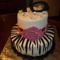 Buttercream Cake With Fondant Zebra And Ribbon Ribbon Was Hand Painted With Cheetah Print Buttercream cake with fondant zebra and ribbon. Ribbon was hand painted with cheetah print.