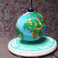 Suspended Earth This cake is actually suspend in the air. It was the coolest thing I have accomplished with cake. It was done for a graduation cake, the...