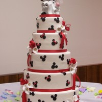 Mickey & Minnie Wedding The Bride was given the topper and wanted a cake to match. So this is what we came up with.