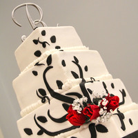 Black And White Cake This was inspired by Aldoska's cake picture. Buttercream with fondant accents. This was also a fixer upper at the venue , my dear...