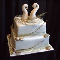 New Zealand Themed Wedding Cake   Chocolate shells. Gumpaste Koru and flax