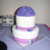 Glitter Flowers Two tier fondant with diamond impression and a dome of small fantasy roses