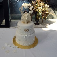 50Th Wedding Anniversary Done for a friend's parent's who were married in a December wedding. The topper is their original which had aged to the perfect...