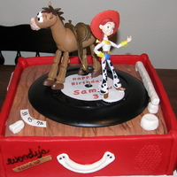 "Sammy's 3Rd Birthday  12"", strawberry, buttercream and lots of fondant. Record spins and plays the theme song ""You've got a friend in me""...."