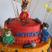 Alvin And The Chipmunks Vanilla cake, chocolate chip filling, fondant, gumpaste and lighted stage....with can lights.