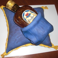 Crown Royal   Thanks to all for the inspiration! Chocolate fudge pillow cake, cream cheese icing, covered in fondant, sugar bottle. TFL.