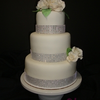 Simply Elegant! A simple white wedding cake for Ana and Eric... with bling! =)