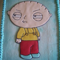 Stewie made from color flow on buttercream icing that was air brushed blue